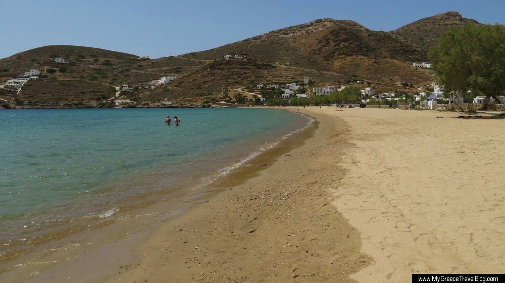 Looking Across The Golden Sand Beach At Gialos Port Village On Ios Island