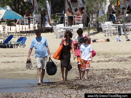 family walks on Agios Georgios beach