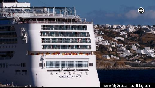 Part of Mykonos Town is visible on the starboard side of the Norwegian Jade cruise ship