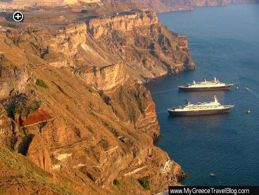 Two cruise ships at anchor below the impressive caldera cliffs on Santorini