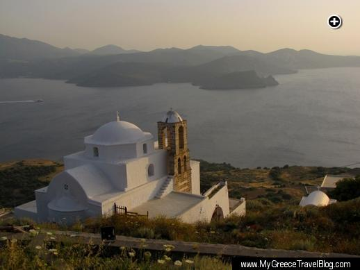 A sunset view of Thalassitra Church and the Gulf of Milos