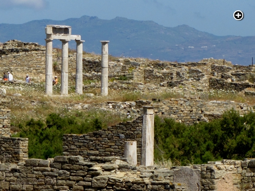 Tourists explore some of the historic ruins on Delos island near Mykonos