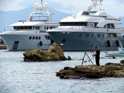 fisherman and yachts and Mykonos