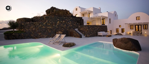 View toward the villas from the infinity pool at Aenaon Villas in Santorini