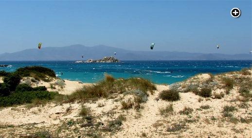 Kitesurfers challenge the wind and wavs off Mikri Vigla beach on Naxos