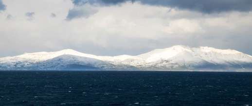 Achim Eckhardt photo of snow on Tinos, as seen from nearby Mykonos island