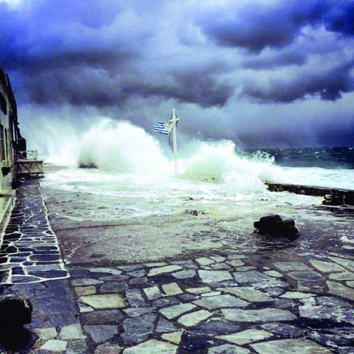 Waves on Mykonos waterfront