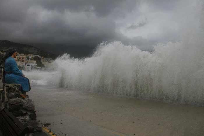 woman watching waves at Diafani