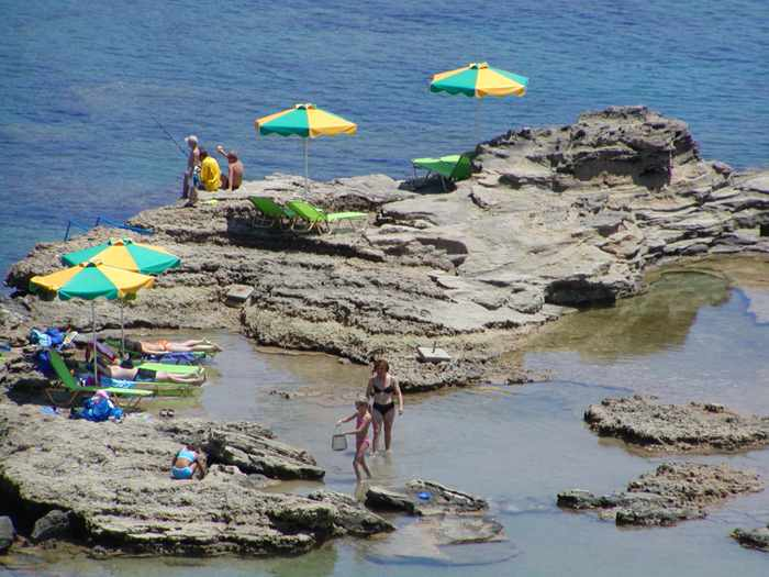 sunbeds on the coast of Rhodes