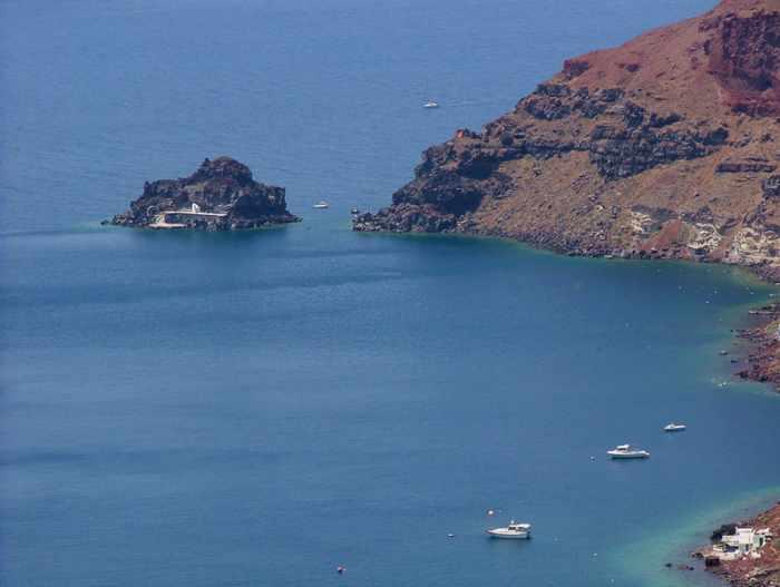 Agios Nikolaos island below Oia