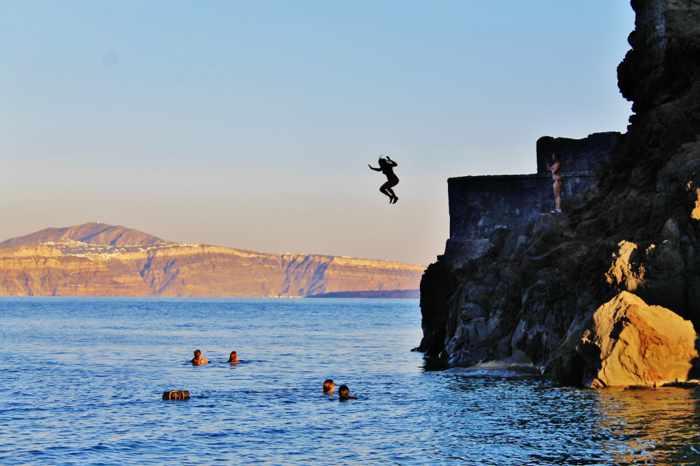 Cliff jumping at Agios Nikolaos islet off Santorini