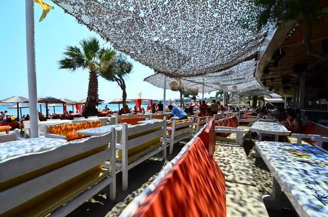 Beachside tables at the Tropicana Club Restaurant at Paradise beach