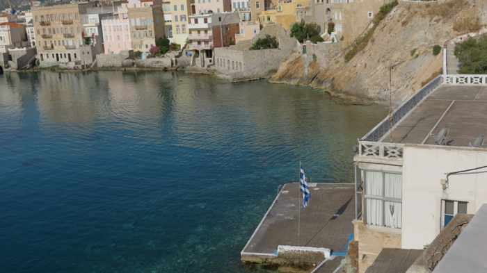 early morning view of a wharf at Asteria beach on Syros