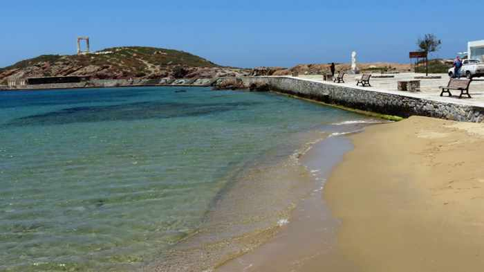 a tiny sand beach near the Naxos port entrance