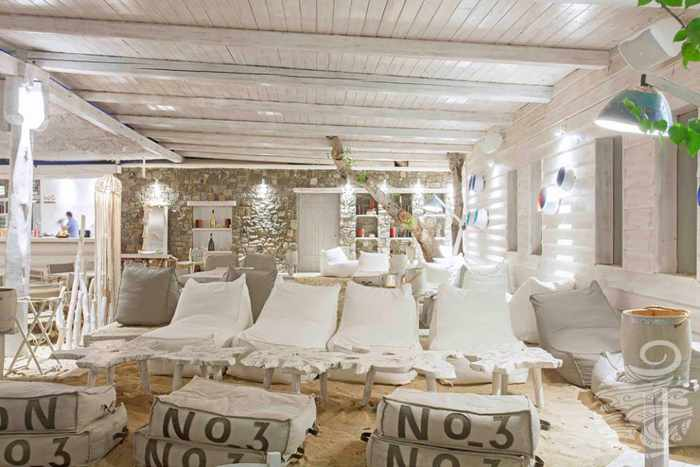 A chic lounge area at Panormos Mykonos Beach Resort