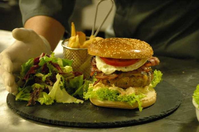 a gourmet burger at Cayenne Mykonos