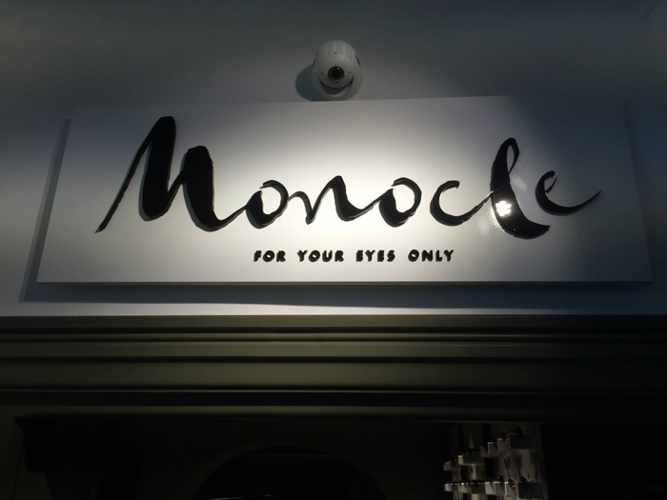 Monocle Mykonos for your eyes only shop sign photo from Woodmade Velentzas Show Room Mykonos Facebook page
