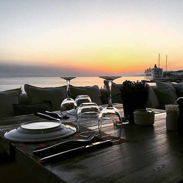 Sunset view from Cayenne restaurant at Tourlos Mykonos photo from the Cayenne Facebook page
