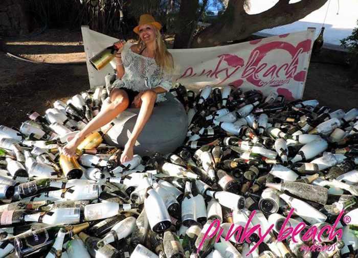 Pinky Beach Mykonos champagne bottle pile