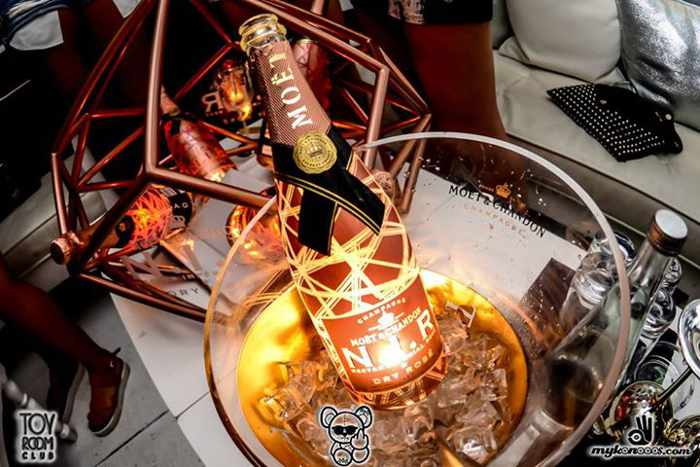 champagne bottles at Toy Room Club Mykonos in a Facebook photo 3 by mykonooos.com