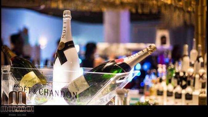 champagne bottles on the bar at Monarch restaurant & beach club Mykonos