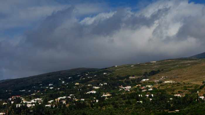 stormclouds over Andros Tiown on island