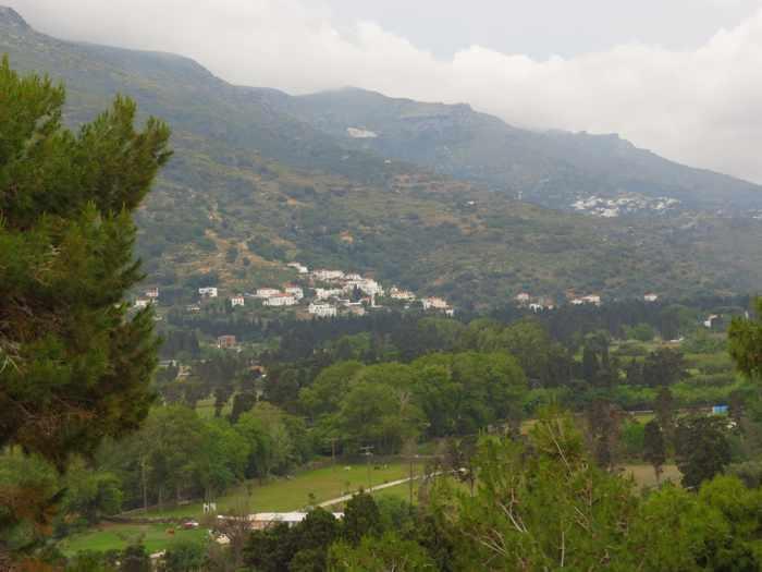 rain clouds pass over hillside settlements near Andros Town