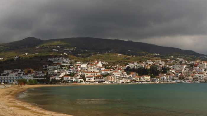 stormclouds over Batsi resort area of Andros