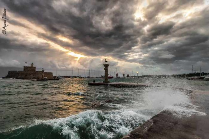Aneza Palaiou photo of winter stormclouds and waves at Mandraki harbour of Rhodes
