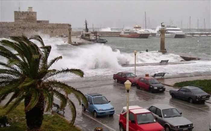 Waves at Mandraki harbourfront of Rhodes Town