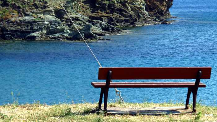 a bench on the clifftop above Stivari Bay