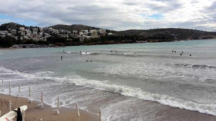 Surfers at Vouliagmeni beach
