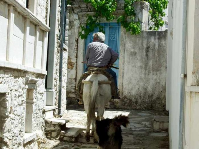 Mike Andrew photo of a man on a donkey in Apiranthos