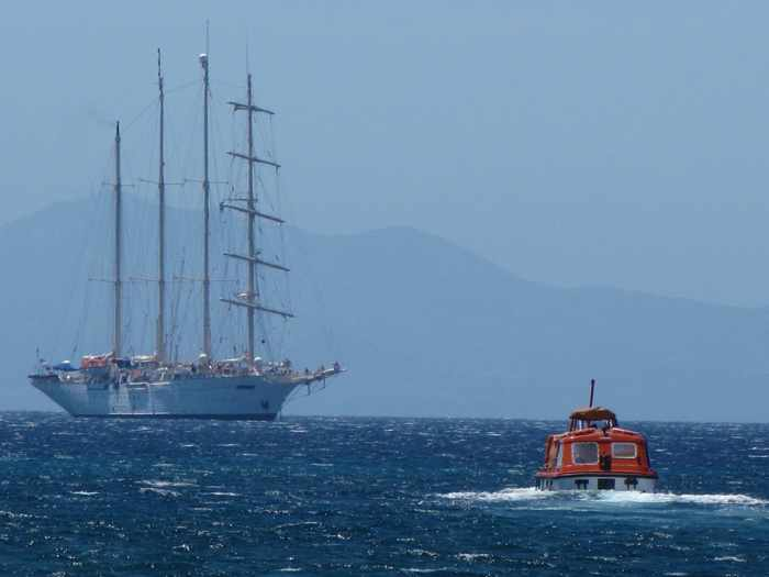 cruise ship and tender boat off Delos island