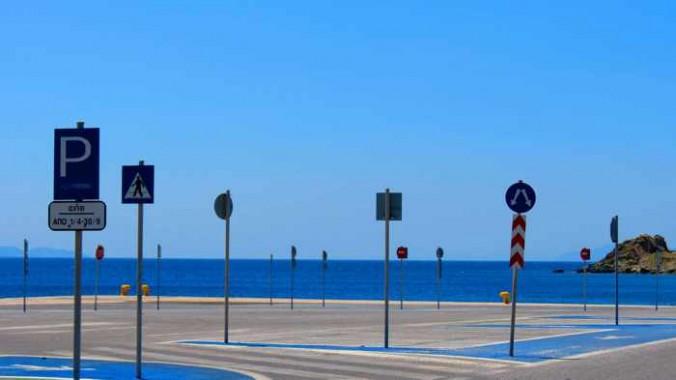 signs at the Tinos port