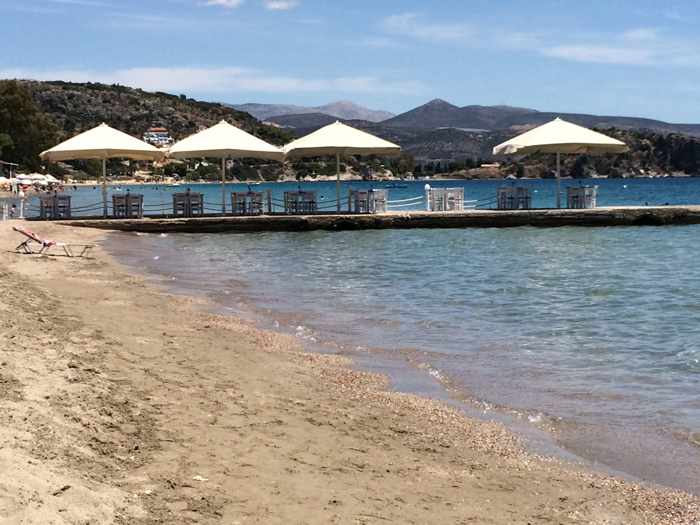 taverna tables on a pier at Tolo beach