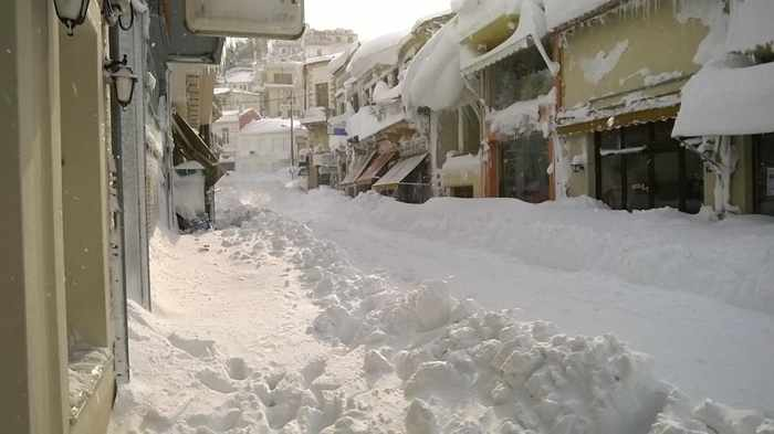 Snow on a street in Kymi on Evia island