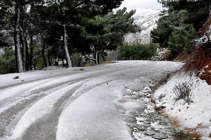 a snowy road on Chios island