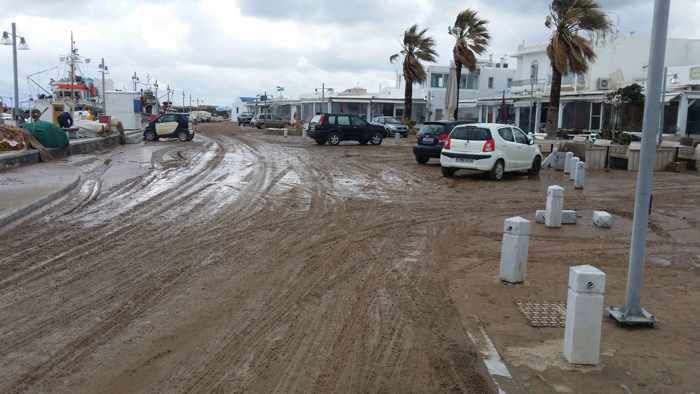 Muddy Naoussa waterfront street