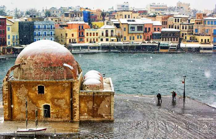 snow falling at the Chania Crete harbourfront
