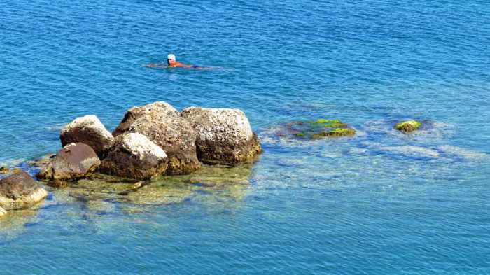 swimmer at the Banieres swimming area in Nafplio