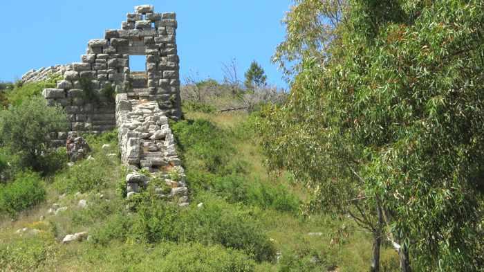 a circuit wall and tower at Ancient Messini