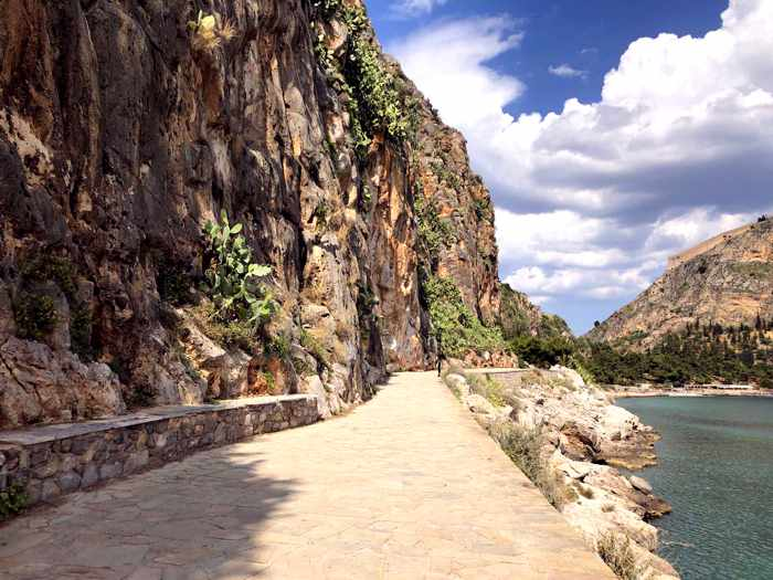 Greece, Peloponnese, Argolida, Nafplio, Arvanitia promenade, path, walkway, coast, tunnel, passageway