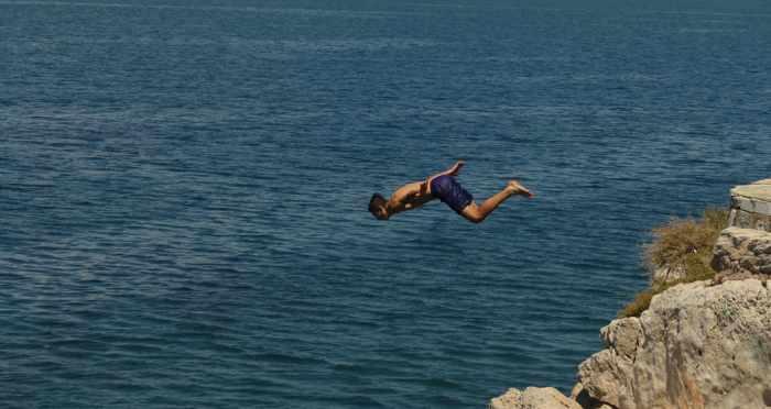 Greece, Peloponnese, Argolida, Nafplio, Arvanitia promenade, coast, cliff, diving, cliff diving