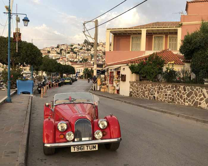 Greece, Greek island, Saronic island, Poros, Poros Greece, Poros island, Poros Town, street, road, buildings, vehicle, car, antique car,