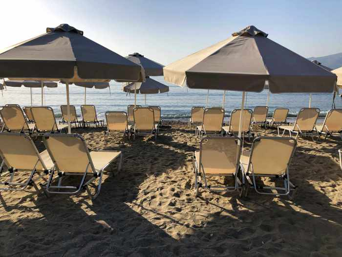 Greece, Greek island, Saronic island, Poros, Poros Greece, Poros island, beach, Kanali beach Poros, Kanali beach, lounge chairs, umbrellas, organized beach