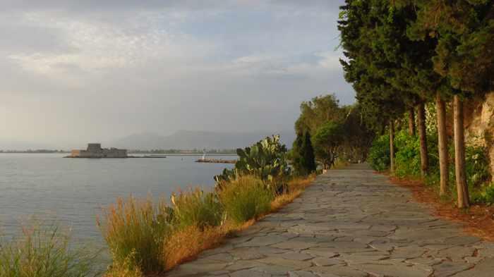 Greece, Peloponnese, Argolida, Nafplio, Arvanitia promenade, walkway, path, coast, seaside,Bourtzi castle, Argolic Gulf,