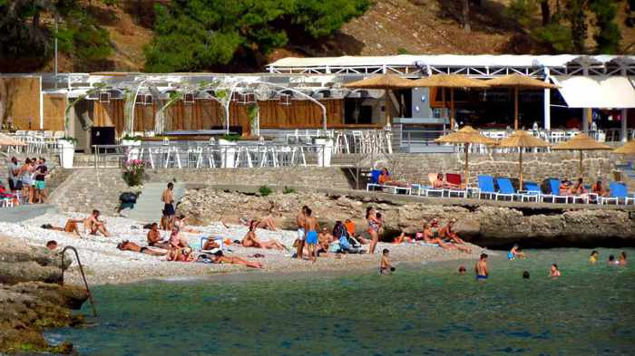 Greece, Peloponnese, Nafplio, Arvanitia, Arvanitia beach, beach, seaside, coast, sunbathers, swimmers, sea,
