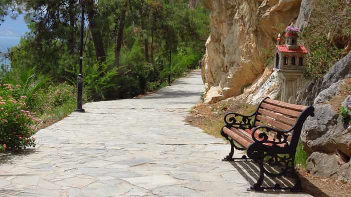 Greece, Peloponnese, Argolida, Nafplio,Arvanitia promenade, path, walkway, bench,,
