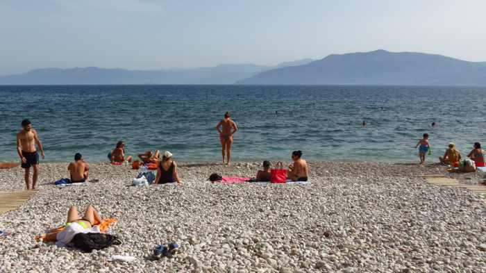 Greece, Peloponnese, Nafplio, Arvanitia, Arvanitia beach, beach, Nafplio beach, seaside, coast, sunbathers, swimmers, Argolic Gulf, sea, water